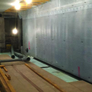 Membrane applied to wall